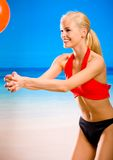Woman playing with gym ball Royalty Free Stock Image