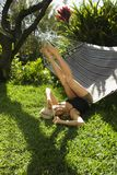Woman playing on hammock. Royalty Free Stock Photography