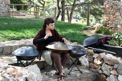 Woman playing hang instrument royalty free stock photos