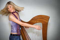 Woman playing harp Royalty Free Stock Photography