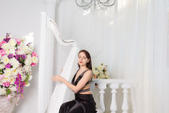 Woman playing the harp in a classical concert Stock Images
