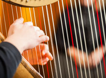 Woman playing the harp Stock Photos