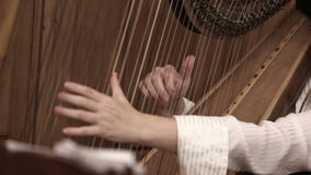 Woman playing the harp stock footage