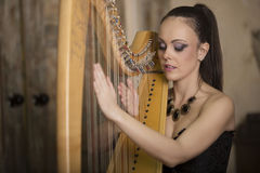 Woman playing the harp Royalty Free Stock Photography
