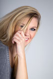 Woman playing with her hair Royalty Free Stock Photography