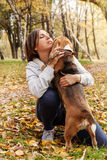 Woman playing with her beagle pet Royalty Free Stock Photography