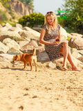 Woman playing with her dog. Royalty Free Stock Photo