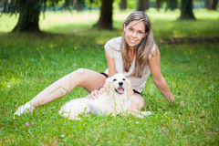 Woman playing with her dog Stock Photos