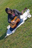 Woman Playing Her Guitar Royalty Free Stock Photos
