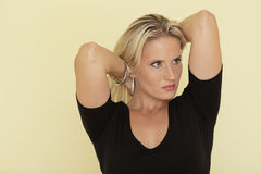 Woman playing with her hair Stock Photos
