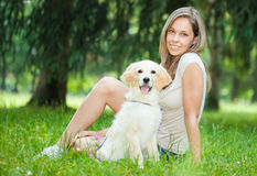 Woman playing with her her golden retriever outdoors Royalty Free Stock Images