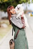 Woman playing with her puppy. Cheerful young woman playing with her puppy royalty free stock images