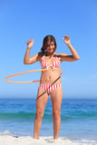Woman playing with a hula hoop Stock Images