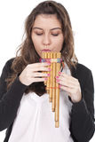 Woman playing a indian flute Stock Image