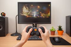 Woman playing on the joystick in a game console. Royalty Free Stock Images