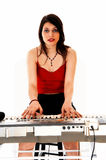 Woman playing on keyboard. Stock Photography