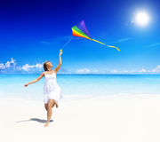 Woman Playing With Kite On Beach Royalty Free Stock Images