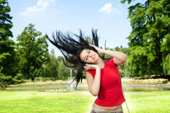 Woman playing and listening music Stock Images