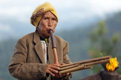 Woman playing Lusheng wind instrument. PANG MAPHA, THAILAND, NOVEMBER 20 : portrait of an old Lahu tribe woman playing Lusheng, a traditional Chinese wind Stock Photo