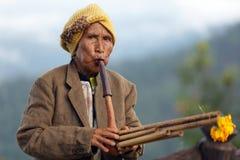 Woman playing Lusheng wind instrument Stock Photo