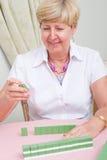 Woman playing mah-jong Royalty Free Stock Photography
