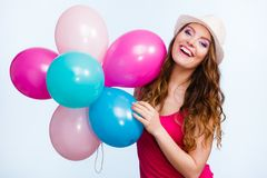 Woman playing with many colorful balloons Royalty Free Stock Images
