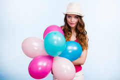 Woman playing with many colorful balloons Royalty Free Stock Photos