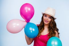Woman playing with many colorful balloons Stock Photos
