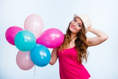 Woman playing with many colorful balloons Stock Images
