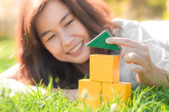 Woman playing mini house model in the garden Royalty Free Stock Images