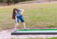 Woman playing miniature golf in the North of Israel Royalty Free Stock Photo