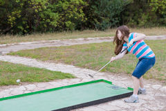 Woman playing miniature golf in the North of Israel Stock Photography
