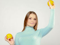 Woman playing with oranges Royalty Free Stock Photos