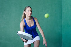 Woman playing paddle holding racket. sportswoman. Stock Photos