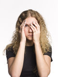 Woman playing peek-a-boo Royalty Free Stock Images