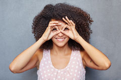 Woman playing peek-a-boo Royalty Free Stock Image