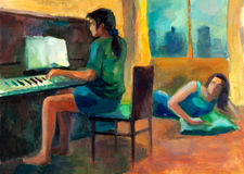 Woman playing the piano Stock Photo