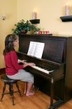 Woman playing the piano Stock Images