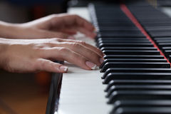 A woman playing piano Royalty Free Stock Photo