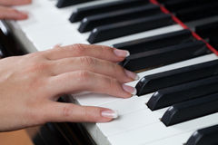 A woman playing piano Stock Photo