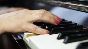 Woman playing the piano. stock footage