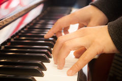Woman playing on piano keyboard Royalty Free Stock Image