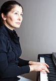 Woman playing piano Royalty Free Stock Photo