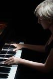 Woman playing piano Royalty Free Stock Photo
