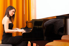 Woman playing piano Royalty Free Stock Photography