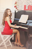 Woman playing the piano, tinted Royalty Free Stock Photography