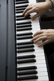 Woman playing the piano with two hands Royalty Free Stock Images