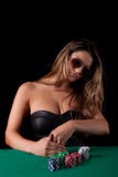Woman playing poker Stock Photo