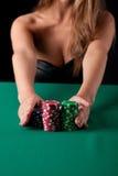 Woman playing poker Stock Photography