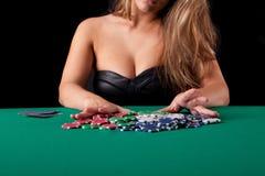 Woman playing poker Stock Photos